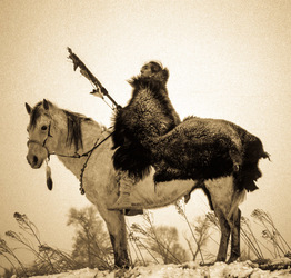 Man In Bison Robe on Horseback